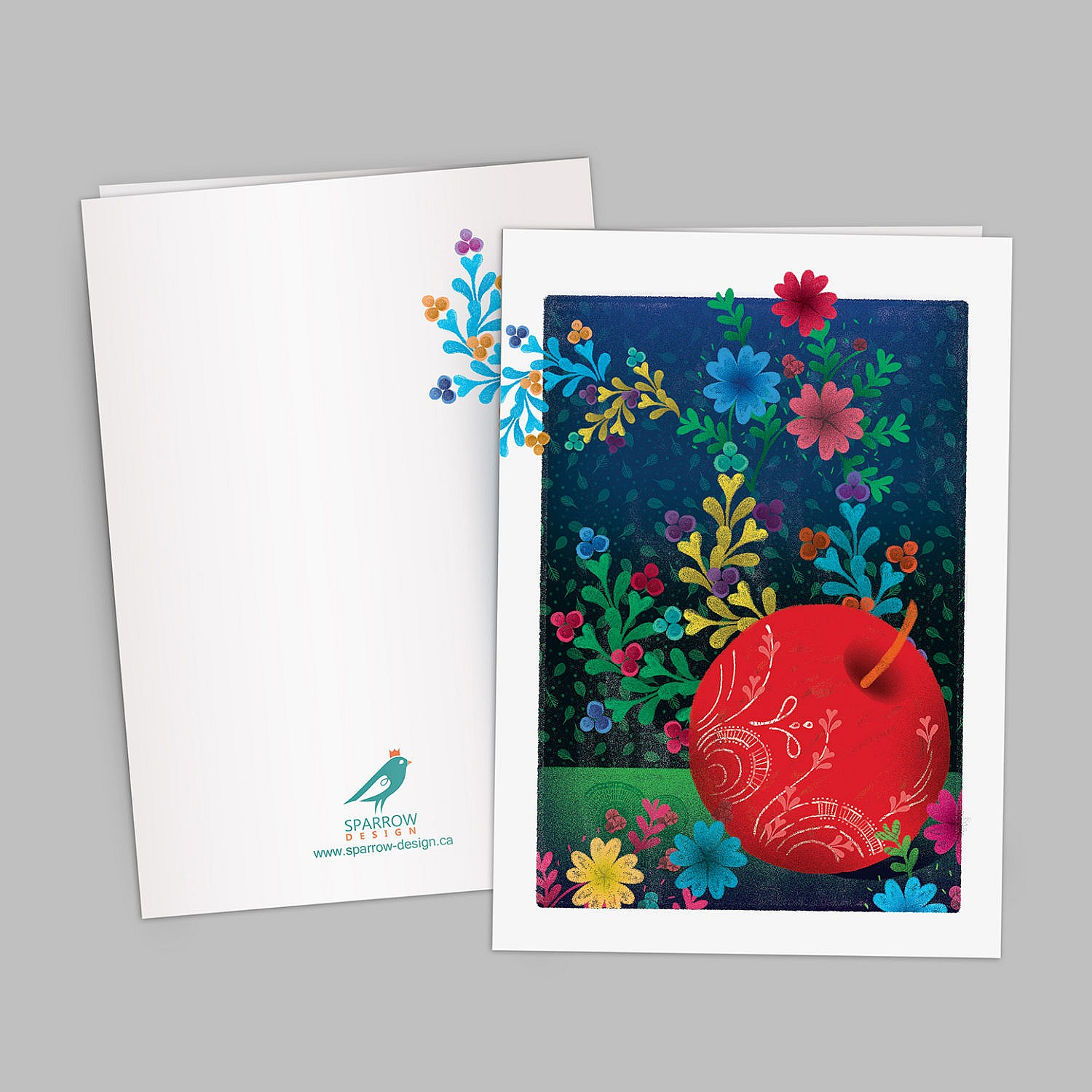 The image include an illustrated greeting card which is designed to celebrate Spring. The image shows two beautiful painted eggs one is showing a red apple which is decorated with tiny flowers. In the background there are colorful flowers. The background is blue and green.
