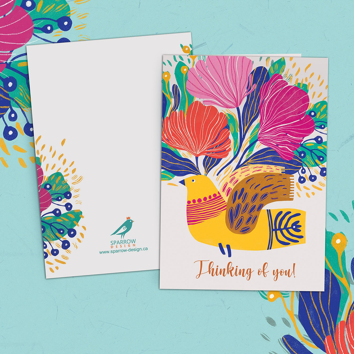 A floral greeting card that reads thinking of you. The flowers are red, dark pink and light pink. There is a yellow bird in the middle.