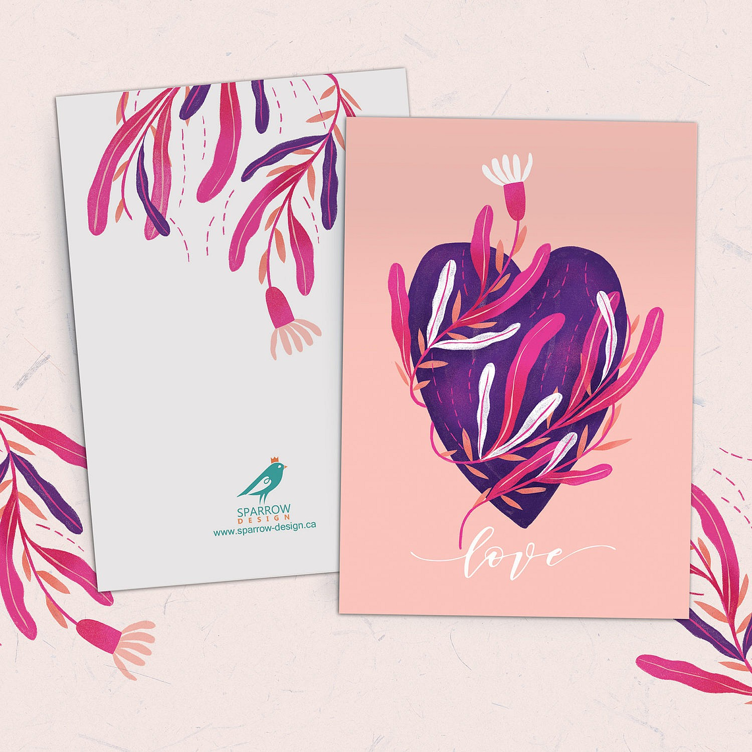 Valentine's card showing a pink heart with light pink and white flowers around it