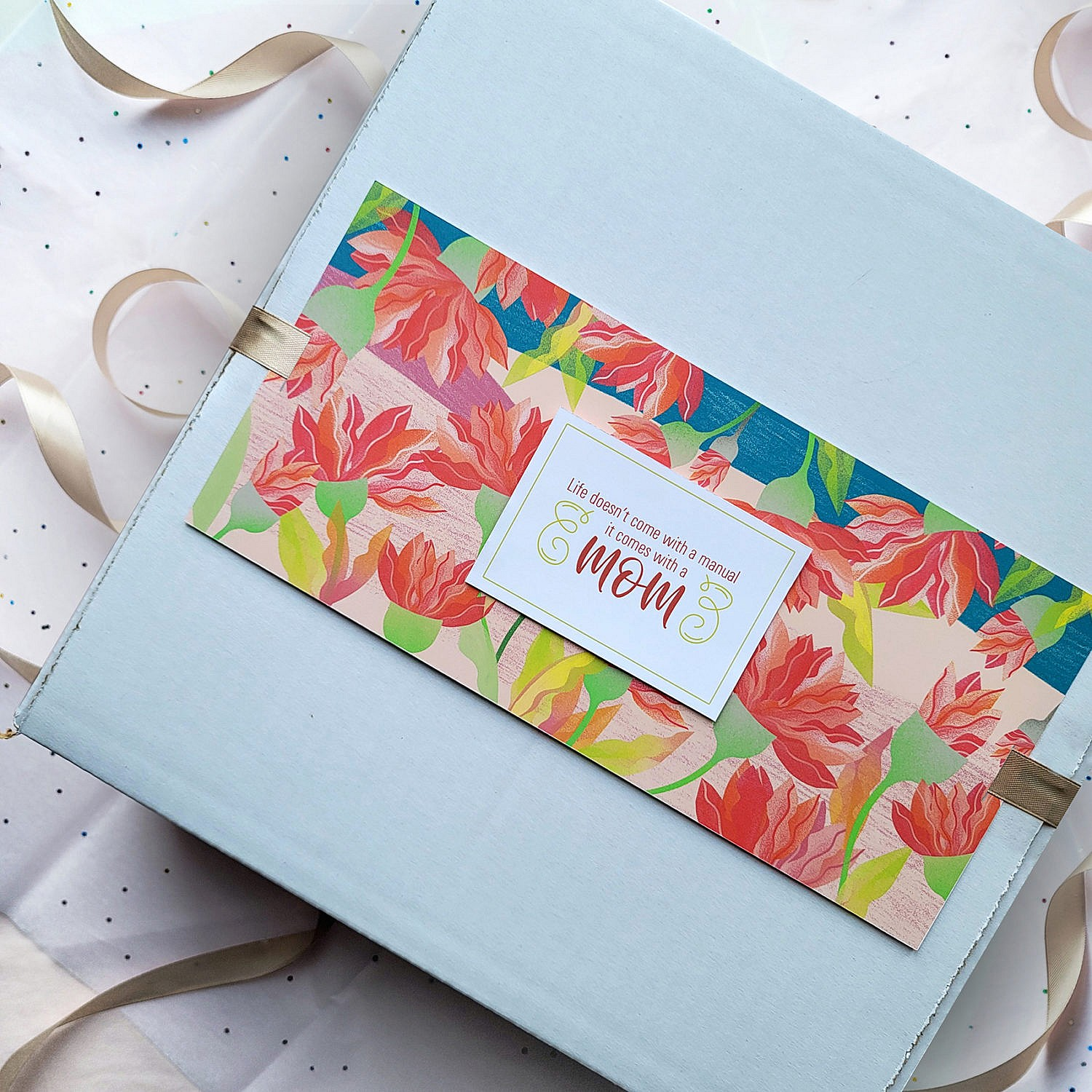 The image is showing a mother's day gift box which is wrapped beautifully.